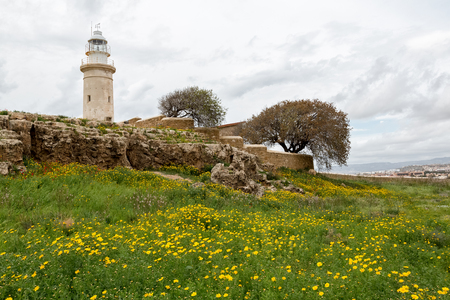 Old lighthouse on the beach of Paphos Cyprus Stock Photo