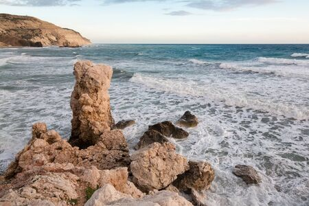 Cyprus beach with Aphrodite rock at sunset, Paphos.