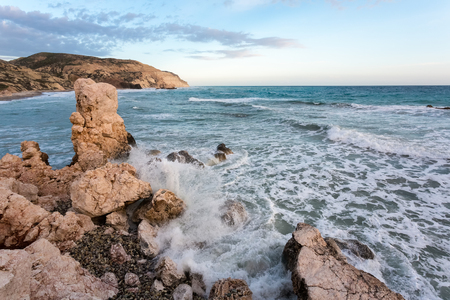 legends: Cyprus beach with Aphrodite rock at sunset, Paphos.