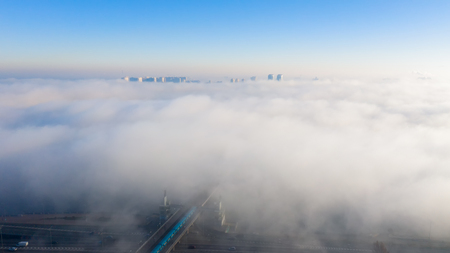 Aerial view of the Monument Motherland, shrouded in thick fog at dawn, Kiev, Ukraine. The concept of the apocalyptic doomsday. Banco de Imagens