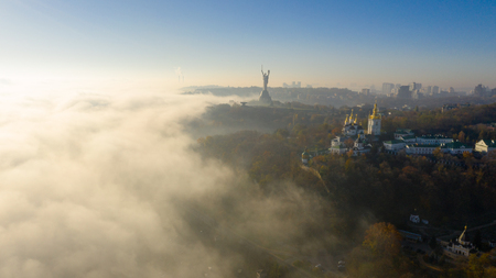 Aerial view of the Monument Motherland, shrouded in thick fog at dawn, Kiev, Ukraine. The concept of the apocalyptic doomsday. Stock fotó