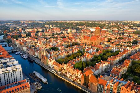 Gdansk is a city in Poland. Gdansk in the morning rays, the sun is reflected from the roofs of the old city.