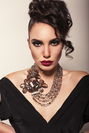 sexy glamour: fashion studio photo of sexy glamour model wtih dark hair with beautiful necklace