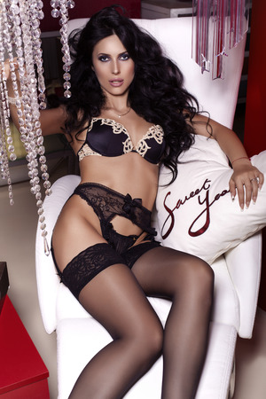 the girl in stockings: fashion photo of sexy woman with black hair in lingerie and pantyhose posing at bedroom