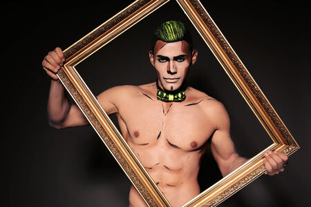 manhood: fashion studio portrait of sexy muscular man with bright painted face