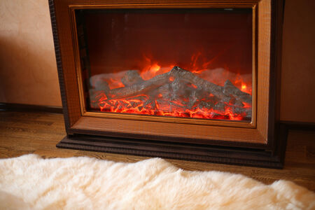 homelike: cozy interior photo of electrical fireplace Stock Photo