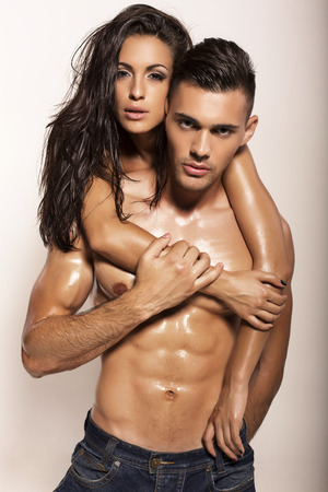 fashion photo of sexy impassioned couple posing in studio