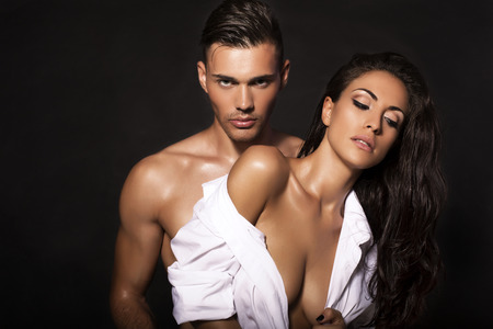 sexy woman naked: fashion photo of sexy impassioned couple posing in studio