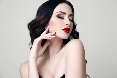 fashion studio portrait of beautiful sexy woman with dark hair and bright makeup Stock Photo