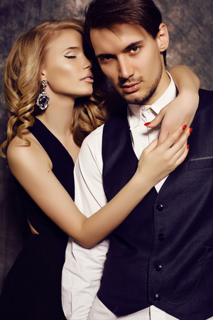 fashion studio photo of beautiful sensual couple in elegant clothes Stok Fotoğraf - 39643148