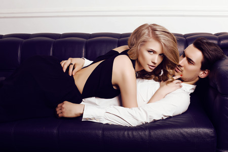 passion: fashion studio photo of beautiful sensual couple in elegant clothes