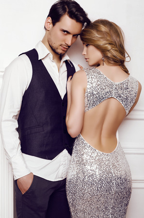 fashion studio photo of beautiful sensual couple in elegant clothes