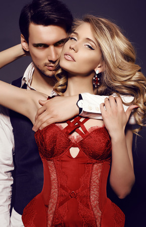 sexual: fashion studio photo of beautiful sensual couple in elegant clothes