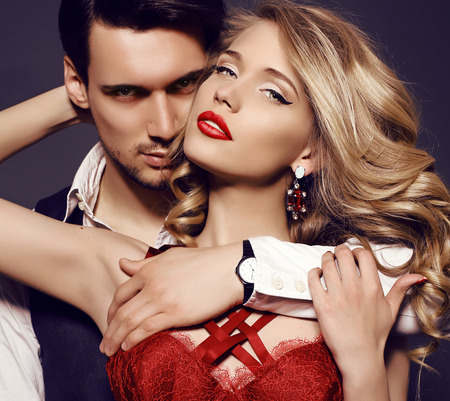 makeup fashion: fashion studio photo of beautiful sensual couple in elegant clothes