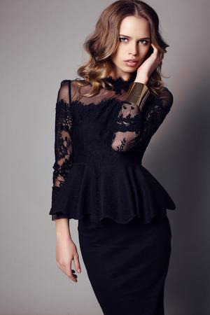 sexy black dress: fashion studio photo of beautiful sensual woman with dark hair in elegant black dress