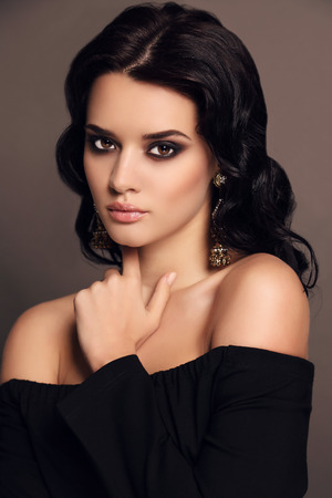 bijou: fashion studio photo of beautiful sensual woman with dark hair and bright makeup,with bijou