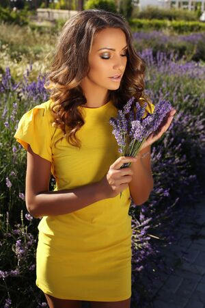 tanned body: fashion outdoor photo of beautiful sensual woman with dark hair and tanned body,wearing elegant clothes,posing in summer lavender field