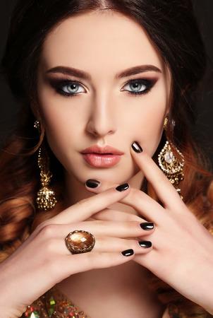 bijou: fashion studio photo of beautiful young woman with  dark hair and bright makeup,with bijou Stock Photo
