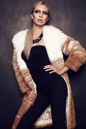 sexy fashion: fashion studio photo of gorgeous woman with blond hair in luxurious fur coat
