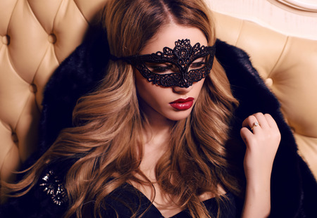 fashion interior photo of beautiful sensual girl with long blond hair in lace veil on face