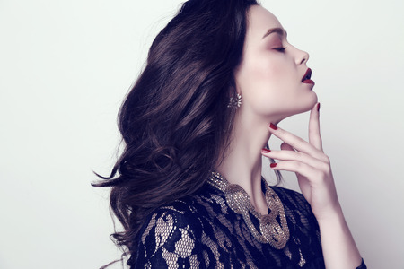 bijou: fashion studio photo of beautiful sensual woman with dark hair and bright makeup with bijou