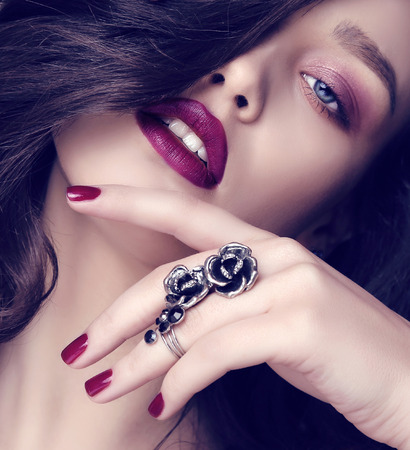 chic woman: fashion studio photo of beautiful sensual woman with dark hair and bright makeup with bijou
