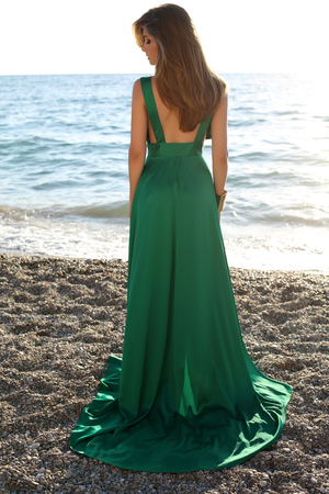 elegant girl: fashion outdoor photo of beautiful sexy girl with blond hair wears luxurious green silk dress posing on summer beach
