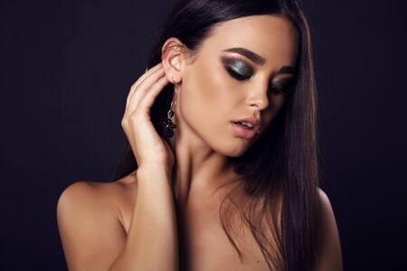 bijou: fashion studio portrait of beautiful sexy girl with dark hair and evening makeup with bijou Stock Photo