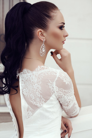 gorgeous girl: fashion outdoor photo of gorgeous young woman with long dark hair in luxurious lace wedding dress