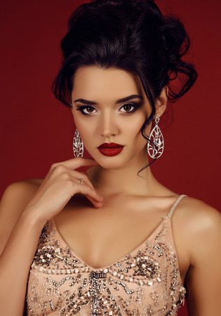 gorgeous girl: fashion studio photo of gorgeous woman with dark hair wears luxurious sequin dress and bijou