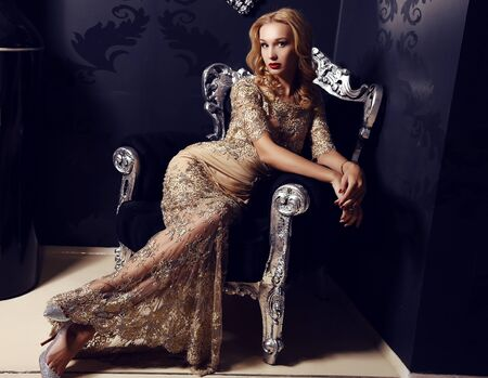 luxurious: fashion photo of gorgeous woman with blond hair  in elegant dress posing in luxurious interior