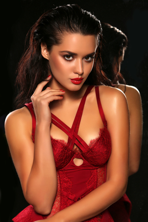 red dress: fashion studio portrait of gorgeous sensual woman with dark hair wears elegant lace lingerie corset