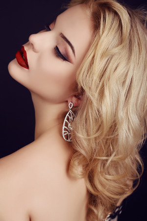 elegant woman: fashion studio photo of gorgeous sensual woman with blond hair and evening makeup, with precious bijou Stock Photo