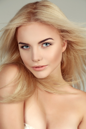 fashion studio portrait of beautiful young woman with blond hair and glowing skin.natural beauty