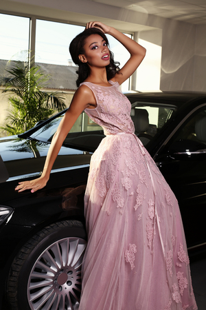 mulatto woman: fashion photo of gorgeous mulatto woman with long dark hair wears luxurious dress,arrived on red carpet event in black car