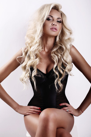 sexy photo: fashion studio photo of gorgeous sexy woman with long blond hair and tanned skin Stock Photo