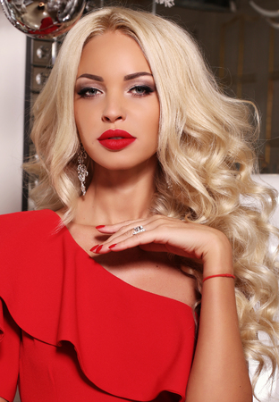 gorgeous girl: fashion interior photo of gorgeous sexy woman with long blond hair wears luxurious red dress and bijou