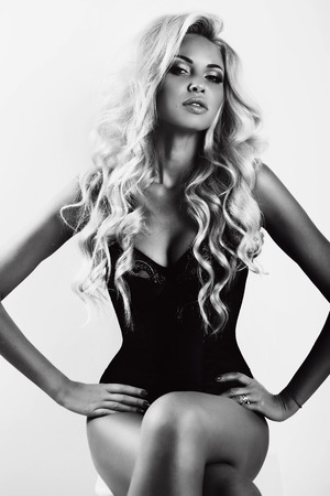 fashion black and white photo of gorgeous sexy woman with long blond hair and tanned skin