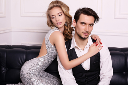 sensual girl: fashion studio photo of beautiful couple, wears elegant clothes, embracing each other