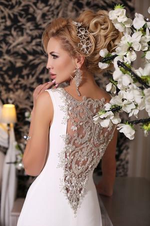 bijou: fashion studio photo of gorgeous bride with blond hair, in luxurious wedding dress with bijou