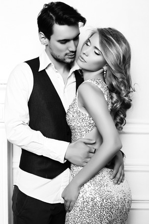 black and white fashion studio photo of beautiful couple, wears elegant clothes, embracing each other Stock Photo - 50537994
