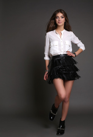 woman white shirt: fashion studio photo of gorgeous sensual woman with dark straight hair and evening makeup,wears elegant clothes and bijou