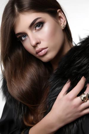 fashion studio photo of gorgeous sensual woman with dark straight hair wears elegant clothes and bijou