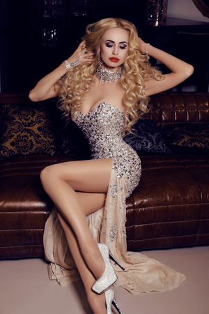sexy fashion: fashion interior photo of gorgeous woman with long blond hair in luxurious dress