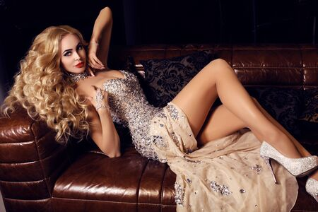 luxurious: fashion interior photo of gorgeous woman with long blond hair in luxurious dress