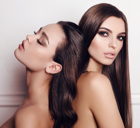 gorgeous: fashion studio photo of beautiful young girls with dark hair and evening makeup