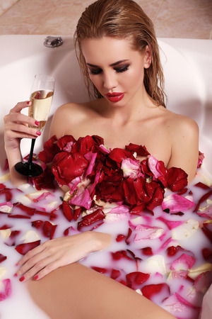 luxurious: fashion interior photo of sexy gorgeous woman with blond hair relaxing in bathroom Stock Photo