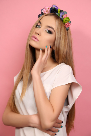 blond hair: fashion studio portrait of beautiful young girl with long blond hair with elegant flowers headband Stock Photo