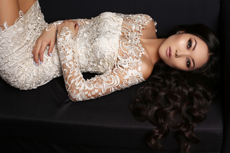 chic woman: fashion studio photo of beautiful sensual asian woman with long dark hair in elegant lace dress