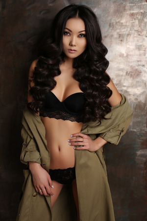fashion studio photo of beautiful sensual asian woman with long dark hair in lingerie